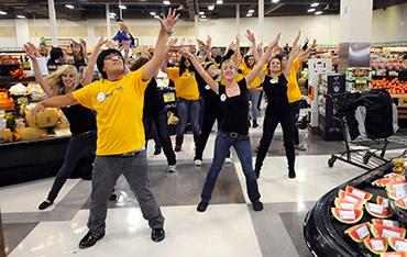 Volunteers in a grocery store flash mob