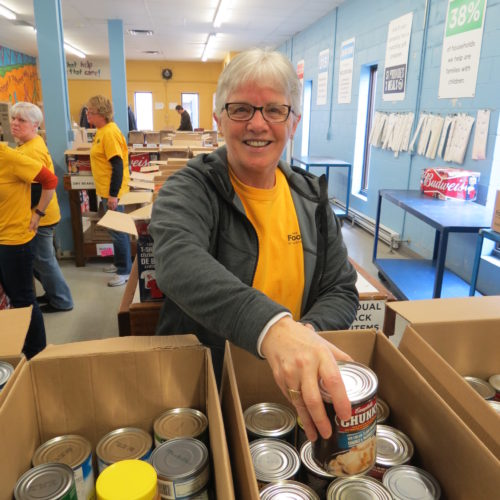 Volunteer sorting cans