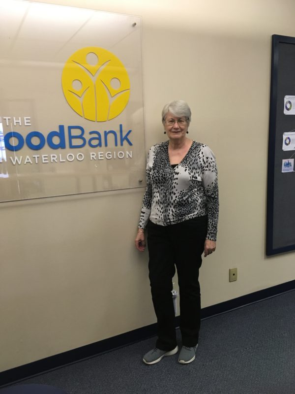 Administration Volunteer with The Food Bank sign