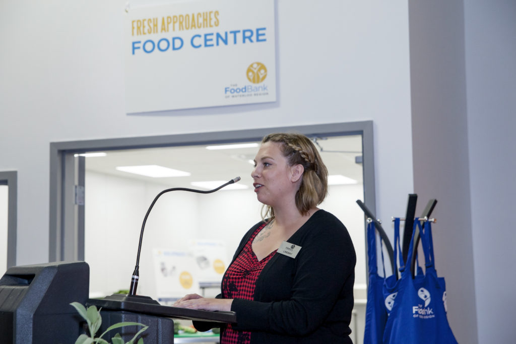 An employee of The Food Bank introduces Volunteers of the Year