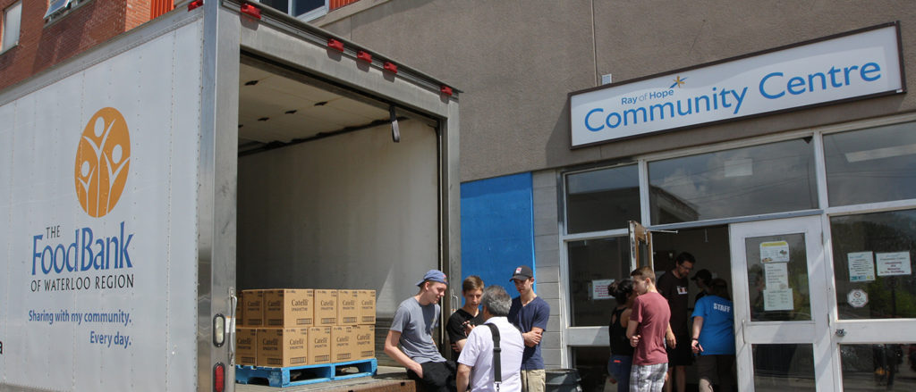 The Food Bank truck being unloaded at Ray of Hope Kitchener