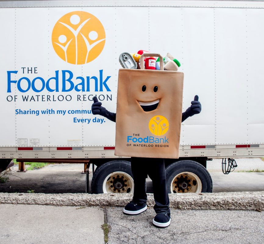Phil the Mascot standing in front of truck