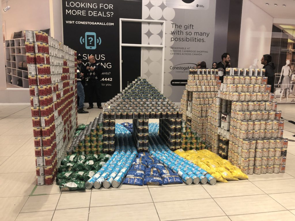 A structure of the Canadian flag and a bridge made out of cans