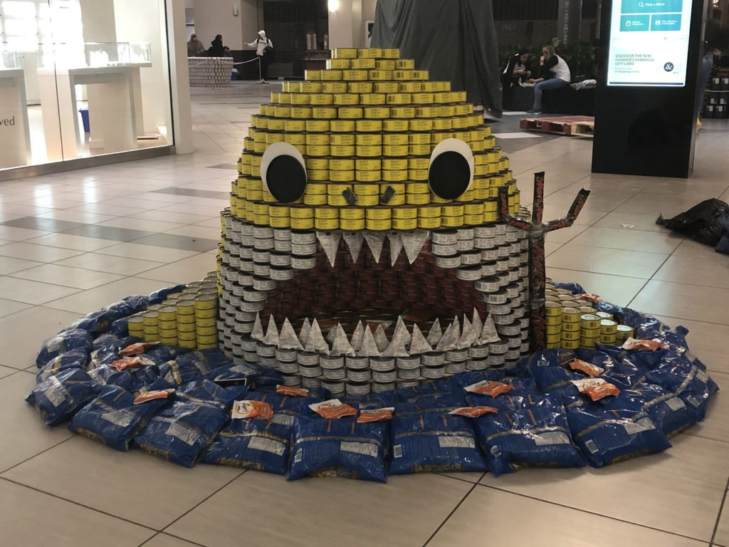 A structure of a shark made out of cans