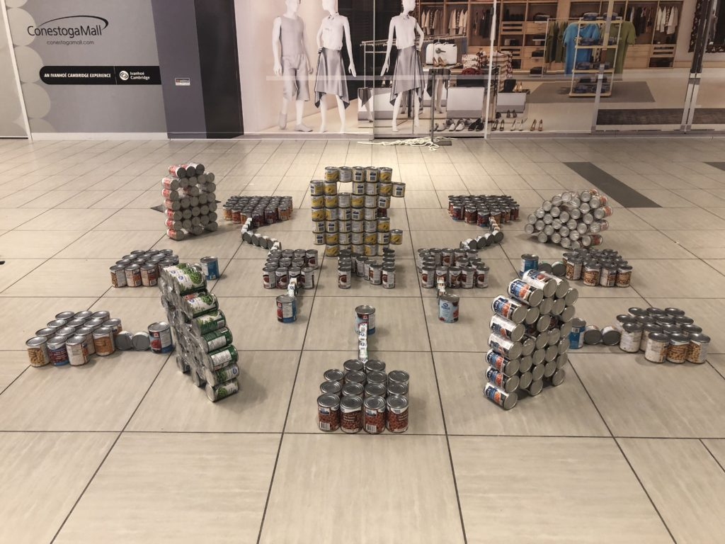 A structure made of cans of Pac Man