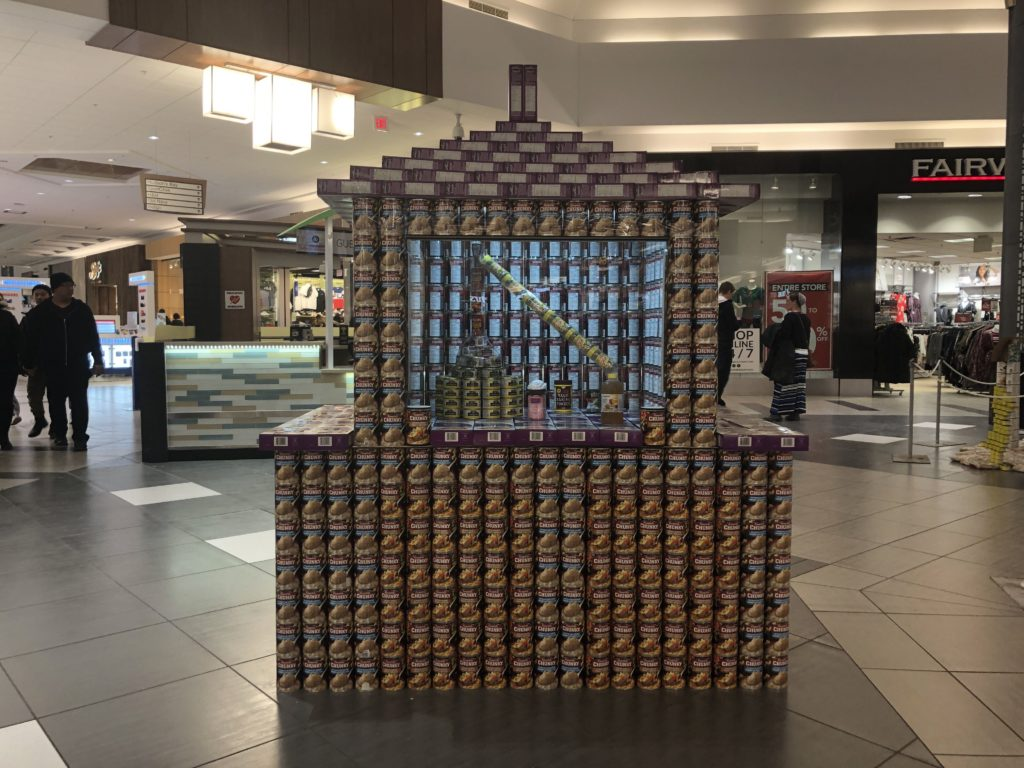 A structure made of cans of a synthesizer