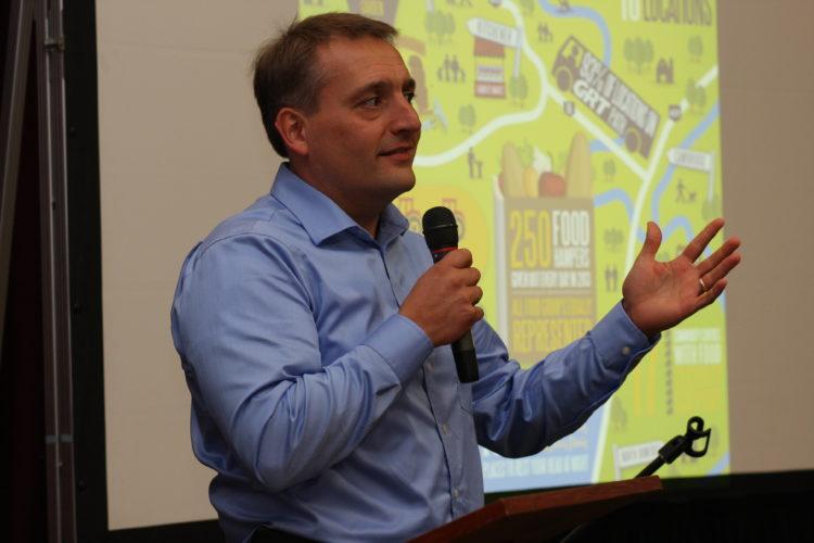 John Neufeld speaking at Waffles in the Warehouse