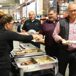 Waffles in the Warehouse attendees enjoying breakfast