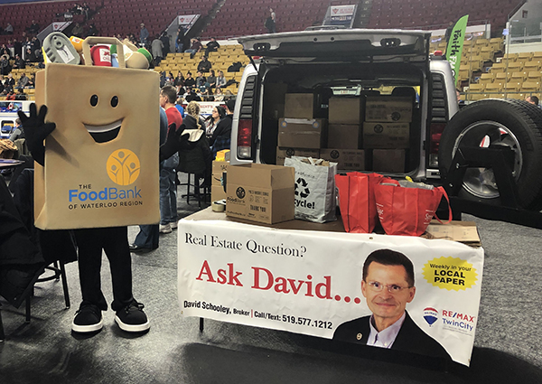 Phil The Food Drive Bag mascot beside the Hummer filled with food